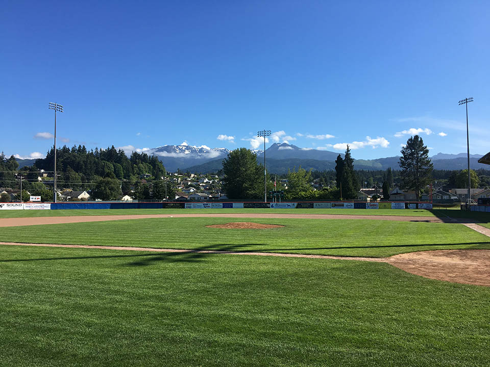 view from civic field showing the olympic mountains in the distance